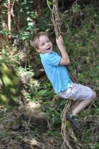 Lucas playing Tarzan on a hanging vine